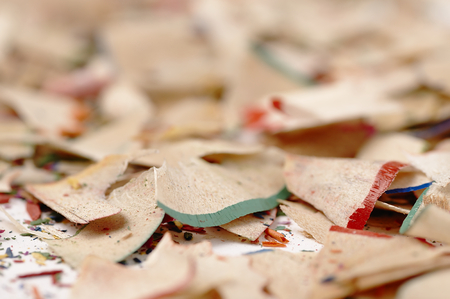 mess: Colorful wooden pencils. Selective focus. Artistic mess on the table.