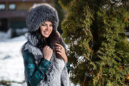 Beautiful young girl in a fur hat photo