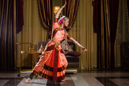 White woman is dancing in traditional indian dress photo