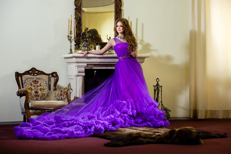 purple dress: Woman in a luxury, long purple dress