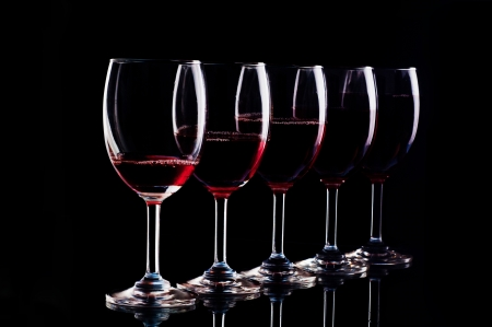 Red wine on a black background  photo