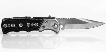 Clasp knife against a white background photo