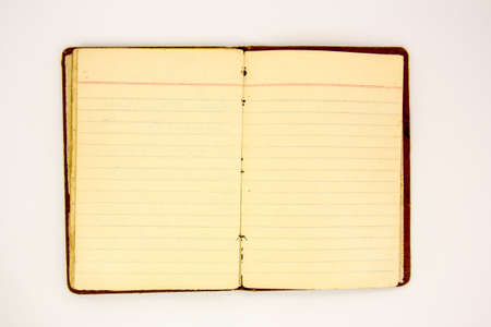 Old notebook open with blank  pages  photo