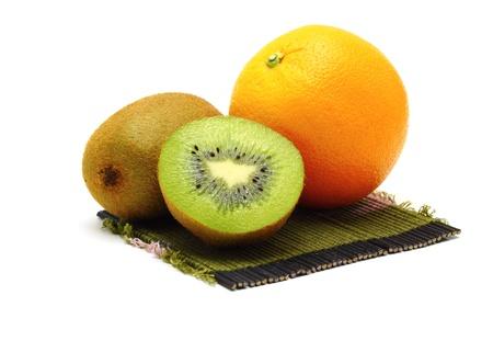 Orange and kiwi fresh fruit on bamboo mats white background Stock Photo - 14812167