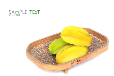 Carambola on basket isolated on white background Stock Photo - 17792712
