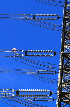 electricity substation: Electric high voltage pillar  Closeup of insulators  Sky background Stock Photo