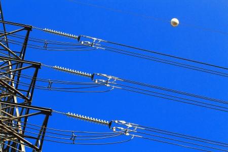 Electric high voltage pillar  Closeup of insulators  Sky background photo