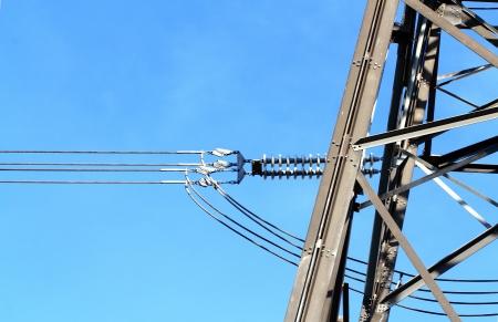 megawatts: Electric high voltage pillar  Closeup of insulators  Sky background Stock Photo