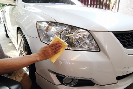 headlights: Hand with a wipe the car polishing, car wash
