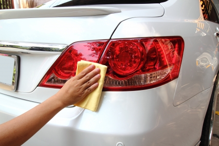 Hand with a wipe the car polishing Stock Photo - 19029535
