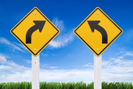 Road signs,  right or left curve on sky background. (Clipping Path Road sign) photo