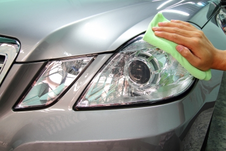 wash cloth: Hand with a wipe the car polishing, car wash