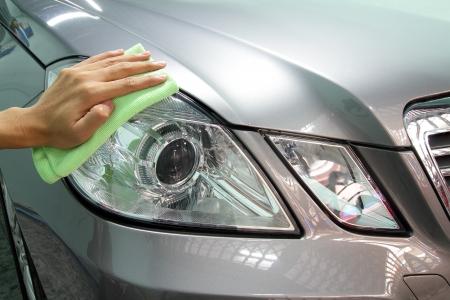 Hand with a wipe the car polishing, car wash