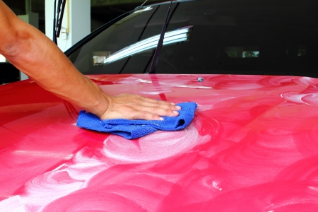 Hand with a wipe the car polishing  Stock Photo - 20225597