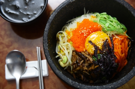 Korean cuisine   bibimbap in a heated stone bowl photo