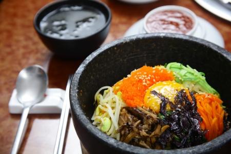 stone bowl: Korean cuisine   bibimbap in a heated stone bowl Stock Photo
