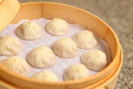 Chinese dumpling in a bamboo steamer