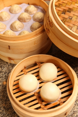 Chinese Steamed Buns and dumplings in a bamboo steamer  photo