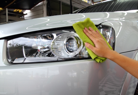 Hand with a microfiber wipe the car polishing Stock Photo