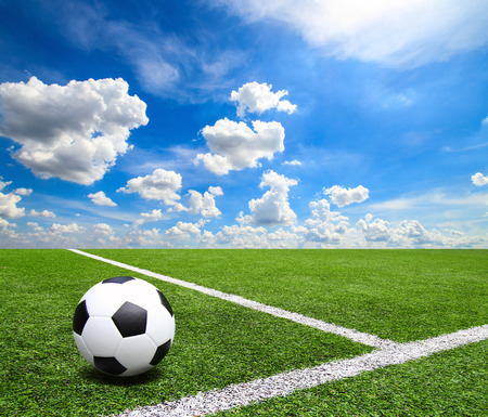 Football and soccer field grass stadium Blue sky background Stock fotó