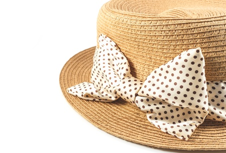 Straw hat with ribbon on white background
