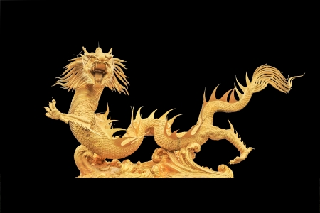 Golden dragon statue on black background photo