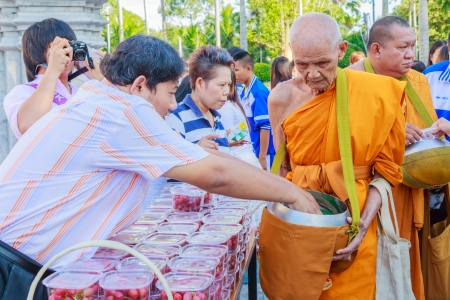 CHONBURI, THAILAND - OCTOBER 2; Unidentified monks walk to collect alms and offerings on October 2, 2013 in Chonburi ,Thailand  Editorial