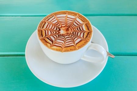 Taza de caf� en la mesa de madera Foto de archivo