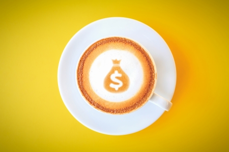 Money sack sign drawing on coffee cup