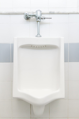 urinal in men Stock Photo