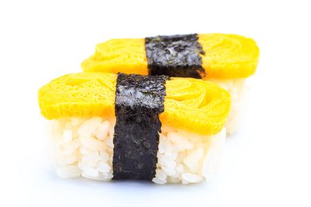 gastronome: Tamago nigiri isolated on white background  Japanese food