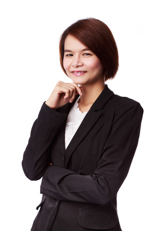 Mujer de negocios asi�tica en traje sonriendo aislados en blanco Foto de archivo