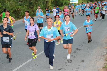 CHONBURI  THAILAND - AUGUST 12: Unidentified marathon runner at Sirikit hospital mini-half marathon 2014 on AUGUST 12, 2014  in Chonburi, Thailand. Editorial