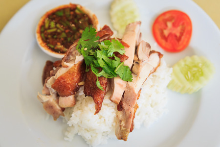 Grilled chicken with Rice and spicy sauce.Thai food