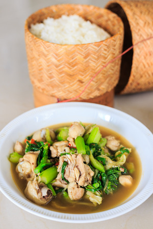 Kang Om or Curry chicken.A savoury thick soup made from spices and vegetables with chicken and sticky rice.Thai cuisine Stock Photo