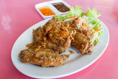 Fried chicken with sauce. selective focus