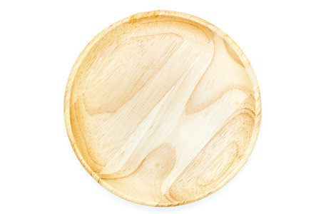 wooden plate top view on white background