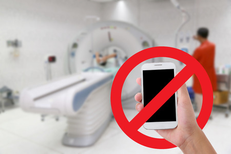 Dont use your mobile phone Recording videos and photos in the hospital.CT scan test in examination room background