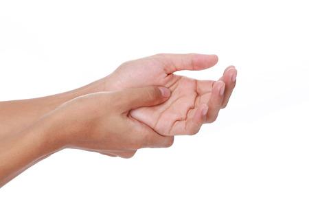 gatillo: Gatillo finger.Woman dolorosa dedo debido al uso prolongado del teclado y el ratón sobre fondo blanco Foto de archivo