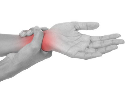 wrist pain: Wrist pain.Female holding hand to spot of wrist pain