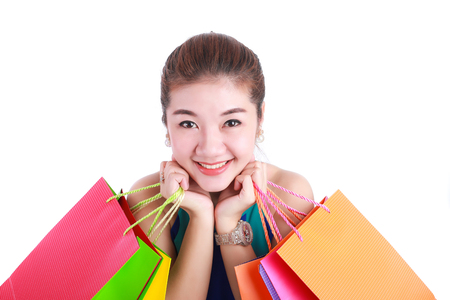 Portrait of young happy smiling woman with shopping bags isolated on white background Stock Photo