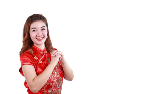 happy Chinese new year. Asian woman with gesture of congratulation isolated on white background