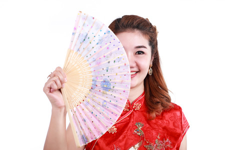 Asian Chinese woman in Traditional Chinese holding blow
