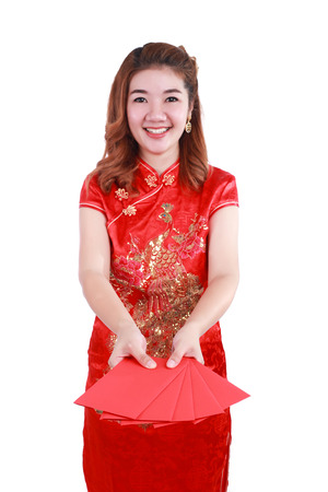 Happy chinese new year. smiling asian woman holding red envelope.Select focus at red envelope