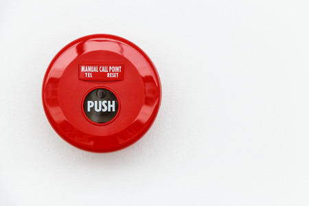 Fire Alarm Equipment.Red manual call point for  Fire alarm on the wall Фото со стока