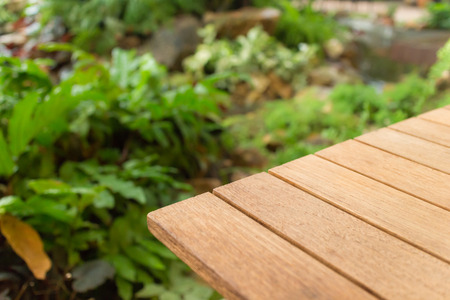 Empty top wooden table and garden background. For product display