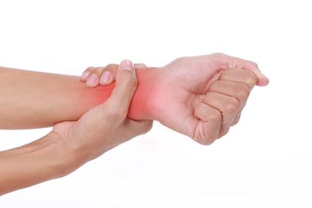 Wrist pain.Female holding hand to spot of wrist pain
