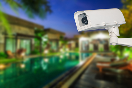 Security camera and private house on the background Stock Photo