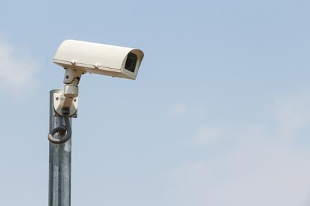 Security cameras or CCTV against sky