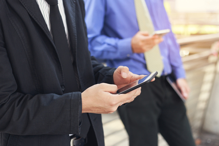 Businessman using mobile smart phone.Concept of business, technology, social media etc.